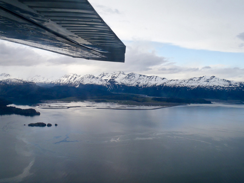 One of the best ways to see the Big Picture in Alaska is to get above it all on a scenic flight. Kachemak Bay, Kenai Mountains, Homer Alaska.