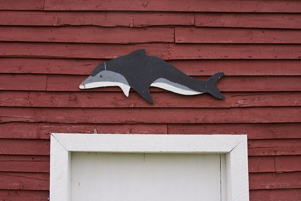 whale sign on red fishing stage, Red Bay, Labrador, Canada