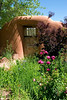 Picturesque gate and gardens at El Rancho de las Golondrinas a 200-acre living history museum near Santa Fe, NM.