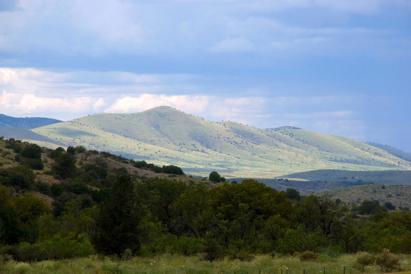 Stormy light casts its magic across the emerald-green hillsides outside Silver City, New Mexico, USA. (Gila environs)