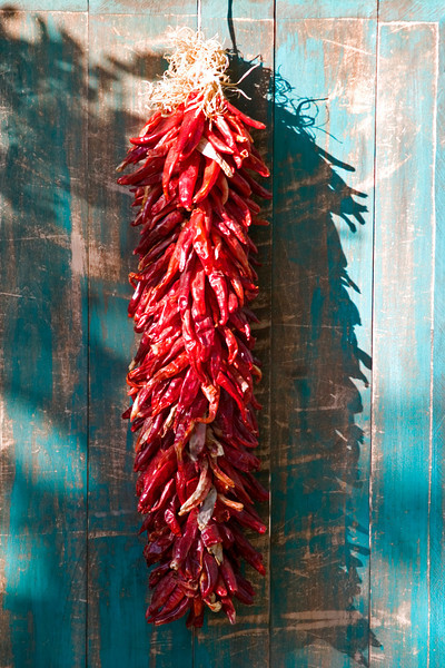 Chile ristra and turquoise gate, Santa Fe, NM