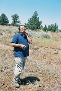 7/3/05 Gil posturing with a sprig of Bacigalupi's Downingia. County Rd 73 southbound heading back to Hwy 299. Modoc County, CA