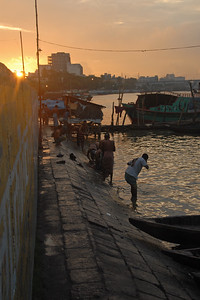 "Early morning sunrise over Buriganga River (Bangla: বুড়িগঙ্গা Buŗigônga ""Old Ganges""). Buriganga is the life line and much happens in and around this river. It is the main river flowing beside Dhaka, capital cityof Bangladesh. With an average depth of 39 feet (12 m) its quite amazing to see the activities along the river. Unfortunately, the river is Dhaka's main outlet of sewage waste and is threatened by pollution and waste. What was mind boggling was that people were using this mucky water to drink, gargle, brush their teeth and take bath all within feets of each other! Amazing immunity system! Dhaka, Bangaladesh"