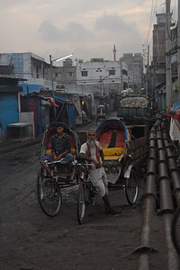 "Cycle rickshaw drivers waiting for customers really early in the morning. Early morning sunrise over Buriganga River (Bangla: বুড়িগঙ্গা Buŗigônga ""Old Ganges""). Buriganga is the life line and much happens in and around this river. It is the main river flowing beside Dhaka, capital cityof Bangladesh. With an average depth of 39 feet (12 m) its quite amazing to see the activities along the river. Unfortunately, the river is Dhaka's main outlet of sewage waste and is threatened by pollution and waste. What was mind boggling was that people were using this mucky water to drink, gargle, brush their teeth and take bath all within feets of each other! Amazing immunity system! Dhaka, Bangaladesh"