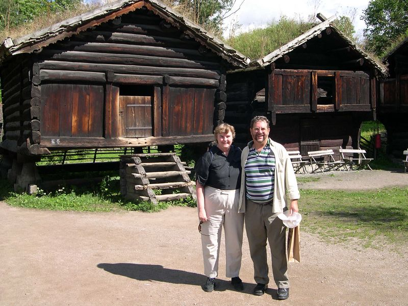 Dick and Susan with historic wooden buildings at the Folk Museum, Oslo
