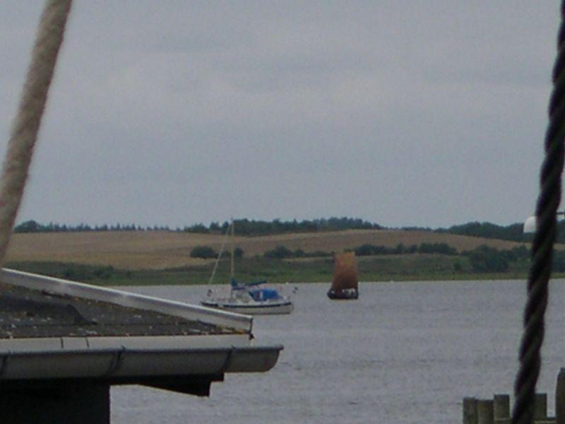 Viking Ship under sail in Roskilde harbor