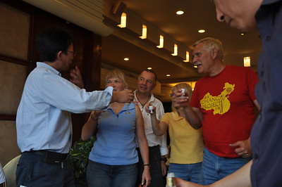 Not to be outdone, the rest of the group got in on the baijiu action!  Here Da-qing (left) begins his toast with (from left to right) Becky, Mike, Diane, and Brad.