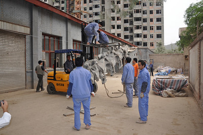 Right outside Da-qing's lab, some of his crew are assembling the first-ever mount of the ginormous sauropod Daxiatitan, using casts made in the lab.  Here the base of the neck is being assembled, suspended from the forklift.  Da-qing and Hailu described Daxiatitan in 2008.  This mount will be part of a forthcoming exhibit dedicated to dinosaurs from Gansu, more or less all of which Da-qing has been involved with.