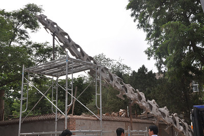 Back outside: the mounted neck of Daxiatitan is almost complete...!  This is part 1 of 2 of a panorama.