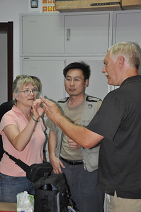 Hailu shows Becky and Brad -- dentists -- the giant teeth of the iguanodontian Lanzhousaurus.