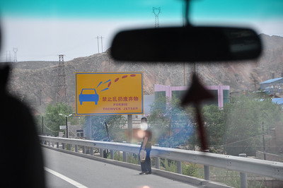 "Road signs are a frequent source of humor in China, and this is one of the best.  In case you can't interpret it, it says ""Forbid to chuck jetsam.""  Best rephrasing of ""Don't litter"" I've ever seen...!  But what I wanna know is: what dictionary were they using to make the translation?!?  And I want ""Forbid to chuck jetsam"" on a t-shirt."