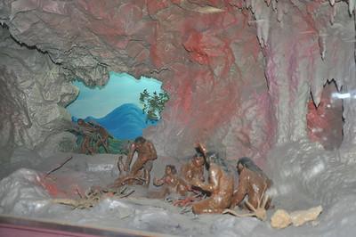 Another restoration of Zhoukoudian Homo erectus in its natural, speleological habitat.