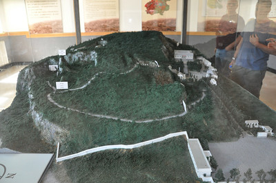 Scale model of the Zhoukoudian site and vicinity.  The museum is the large building in the upper right.  For whatever reason, pretty much all site-based museums I've been to in China have these little dioramas in the entrances to their museums, and I love them -- they're fabulous!