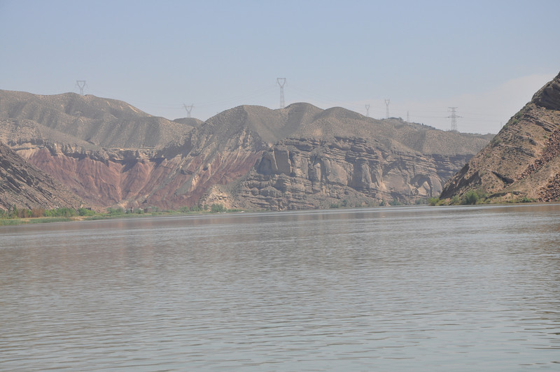 At the left of this photo is another side canyon; the Hekou Group strata there are particularly red.  At the other end of the canyon lies the Geopark museum.