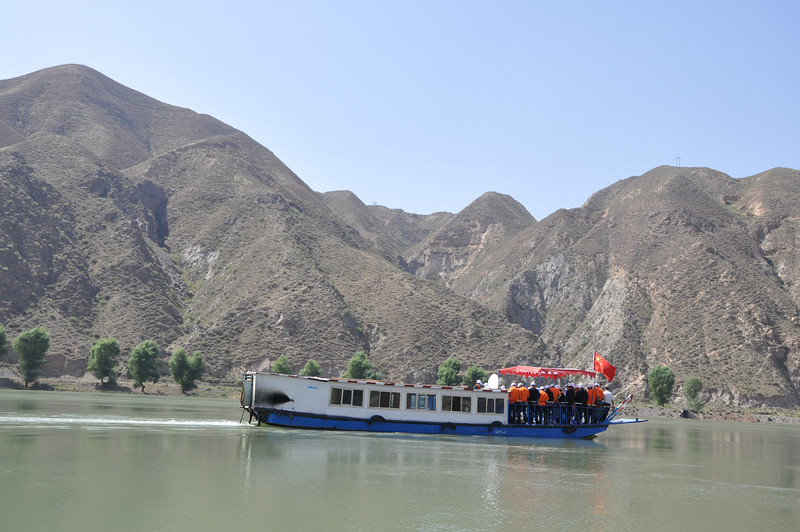 Here's another boat we passed; it seemed adrift, and we got quite close.  The Chinese people aboard seemed rather puzzled by the presence of Westerners out on the river!