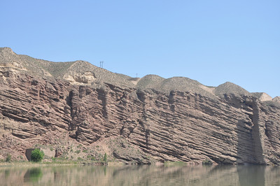 There is obviously a lot of structure in the Cretaceous strata in this area; even where folds aren't obvious, the strata are tilted to varying degrees; they make a nice angular unconformity with the overlying, flat-lying, unperturbed Cenozoic strata.  Here's some of the tilted Hekou Group strata.