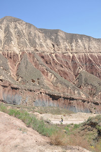 The scenery along the path is spectacular, even to the non-geologist.  The angular unconformity the Hekou Group has with the overlying strata is particularly well exposed here.  Becky is in the foreground on the trail, for scale.
