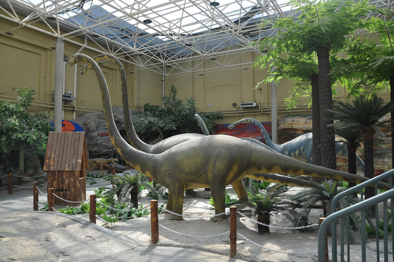 "The big, rubbery sauropods.  Another big issue with this hall is that the roof is greenhouse-like, so the room is very hot (at least in the summer).  Heat like this speeds up the natural degradation of rubber compounds, like the ones used to make the ""skin"" of these restorations, so the room smelled something like a tire shop."