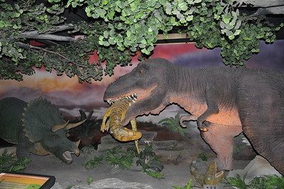 ...and we're back to the laughably awful with this tyrannosaur clutching its next meal in its mouth, while a cheek-less, overtoothed Triceratops makes commentary.