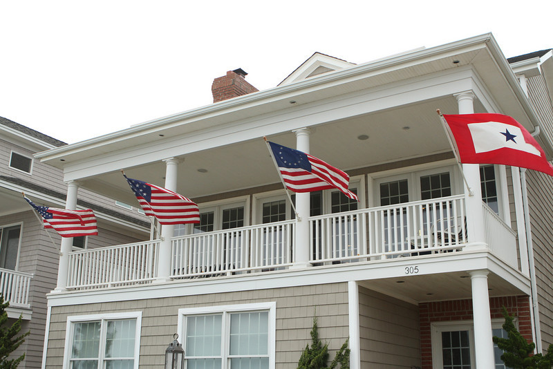 Four different flags for different periods fly in the sea winds