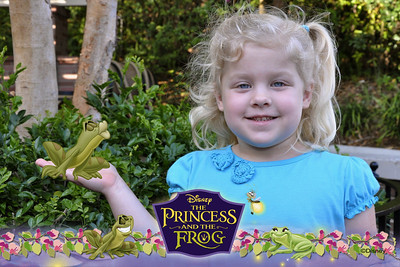 Kamryn poses with the Frog Prince.