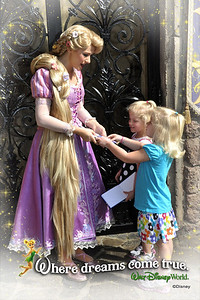 Kamryn & Sydney get autographs from Rapunzel.  She is Kamryn's favorite, so we waited 1.5 hours to meet her.