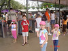 """The kids holding their """"Key to the World"""" cards just before going through the turnstile to get into Magic Kingdom."""