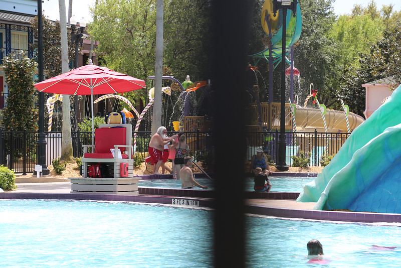 Found Santa Claus on his vacation...  Had to shoot it TMZ-style through the fence surrounding the pool.