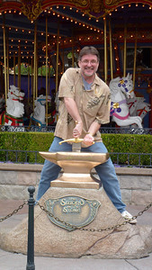 Mike attempting to take the sword out of the stone.