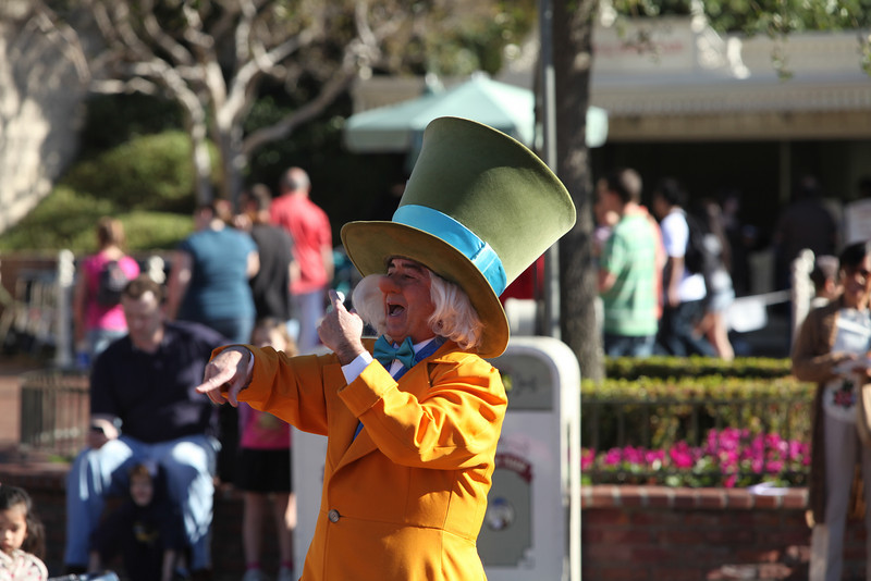 The Mad Hatter is conducting a band of marching ladies with strollers!