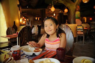 Sarah enjoying tomato soup with paneer cheese