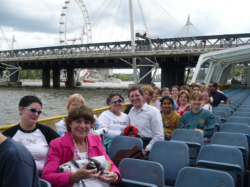the start of our boat ride on the River Thames.<br /> <br /> from front:  Tierah, Twyla, Linda, Paul & Joyce, Graham, Bharvi, Kristen, Jackie, Steff, Jenn, Suzi, Shannon, & Greg