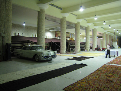 A section of the enormous hall that houses a small part of the Sheikh's car  and dhow collection.  The bedu tent is enormous and next to it is a functioning mosque, then a tank containing 4 or 5 dhows.