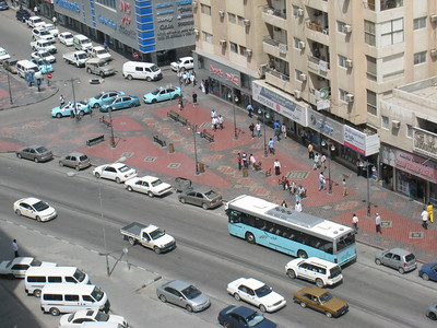 Looking down the street from the balcony.  Public buses and taxis are an aqua colour, relfects the colour of the sea around Qatar maybe.