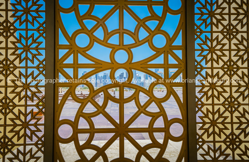 Doha's modern business district viewed through an Islamic design screen