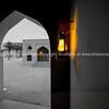 Lanterns glow golden in Arabic design archways as sun gows down