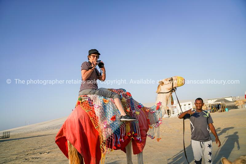 Camel riding tourist