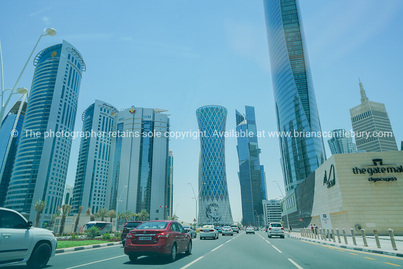 Wide-angle street and buildings in ultra-modern business district of Al Dafna.