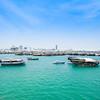 Boatin  harbor Doha with turquoise Persian Gulf water Qatar.