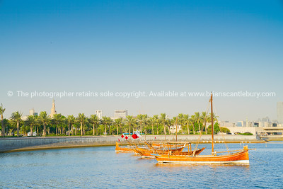 Dhow moored in bay with old town part of Doha city in background.