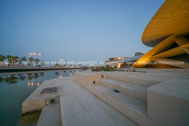 Exterior as lights come on National Museum of Qatar