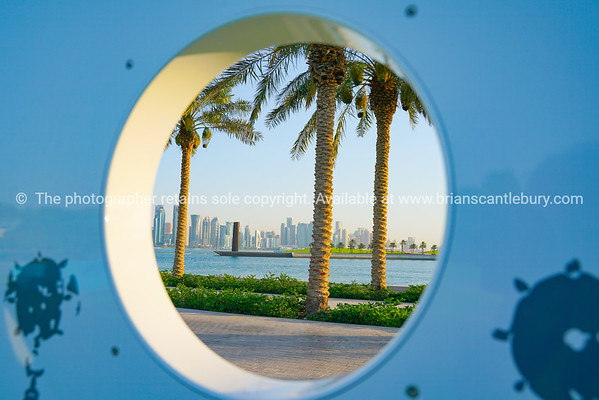 The Corniche artworks. A view of high-rise business district through circular hole