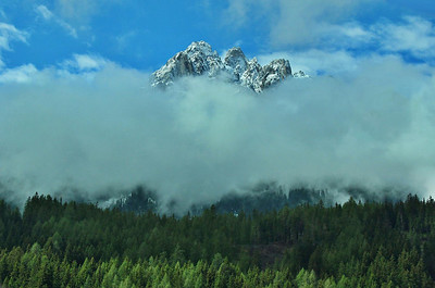 """The clouds slowly gave way to the sun that morning and in the process produced a variety of """"peek-a-boo"""" mountain scenes like this."""