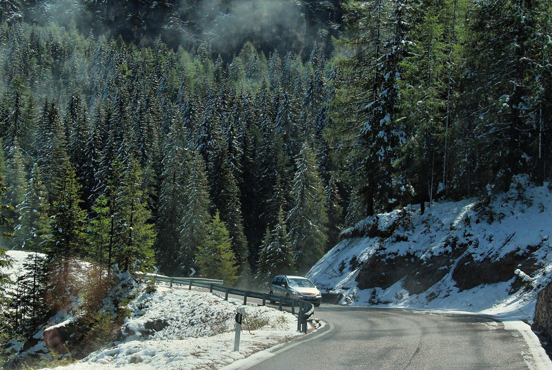 The high pass in the mountains still had overnight snowfall lingering. This was before we reached Lake Misurina.