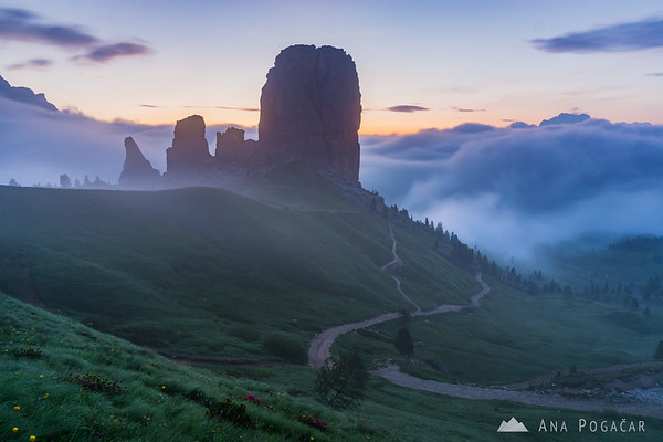 Mists around Cinque Torri before sunrise