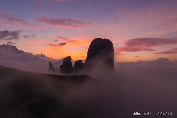 Pink mists around Cinque Torri before sunrise