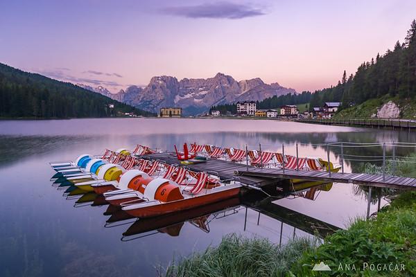 Colorful paddle boats on Lago di Misurina before sunrise