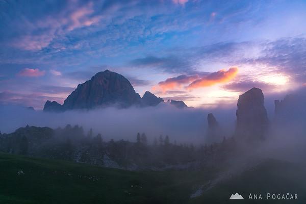 Mists around Tofana and Cinque Torri at sunrise