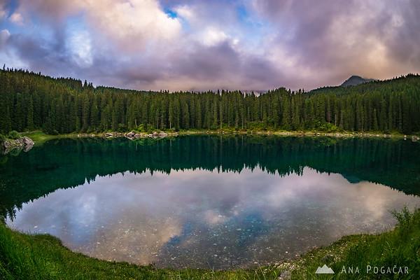 Lago di Carezza at a cloudy sunset