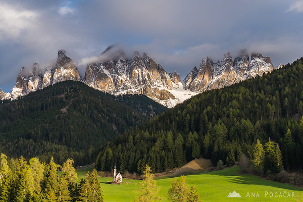 San Giovanni church and the Odle range in late afternoon light